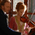 Gerda and The Lieutenant playing passionate duos on the violins